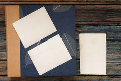 Vintage photo album on a rustic wood background Royalty Free Stock Photography
