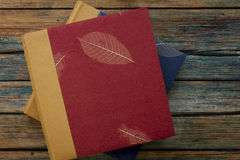 Vintage photo albums or books on a rustic wood background Stock Image
