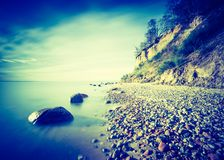 Vintage photo of Baltic sea shore with cliff in Gdynia Stock Photo