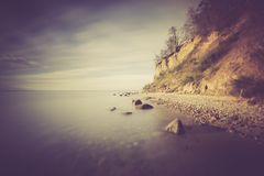 Vintage photo of Baltic sea shore with cliff in Gdynia Stock Image