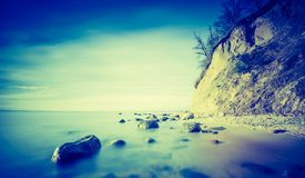 Vintage photo of Baltic sea shore with cliff in Gdynia Stock Photography