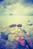 Vintage photo of beautiful Baltic sandy coast with old military buildings Stock Image