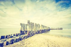 Vintage photo of beautiful Baltic sandy coast with old military buildings Royalty Free Stock Photography