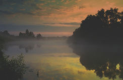 Vintage photo of beautiful foggy sunrise over the river Stock Photography