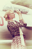 Vintage photo of beautiful girl and plane Royalty Free Stock Image