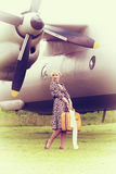 Vintage photo of beautiful girl and plane Stock Photo