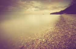 Vintage photo of beautiful landscape of rocky sea shore Royalty Free Stock Image