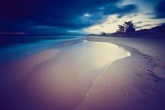 Vintage photo of beautiful long exposure landscape of sea shore Stock Images