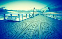 Vintage photo of beautiful seascape with wooden pier. Stock Photography