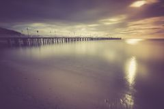 Vintage photo of beautiful seascape with wooden pier. Stock Photos