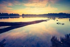 Vintage photo of beautiful sunrise over calm lake. Royalty Free Stock Images