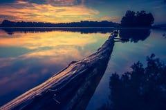 Vintage photo of beautiful sunrise over calm lake. Royalty Free Stock Photos