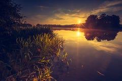 Vintage photo of beautiful sunrise over calm lake. Royalty Free Stock Photography