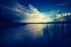 Vintage photo of beautiful sunset over calm lake Royalty Free Stock Photo