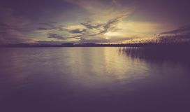 Vintage photo of beautiful sunset over calm lake Royalty Free Stock Photography