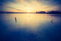 Vintage photo of beautiful sunset over calm lake Stock Photo
