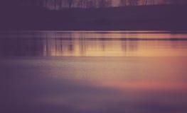 Vintage photo of beautiful sunset over calm lake Royalty Free Stock Photos
