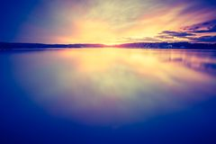 Vintage photo of beautiful sunset over calm lake Stock Photography