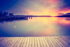 Vintage photo of beautiful sunset over calm lake Royalty Free Stock Image