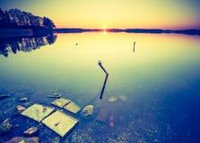 Vintage photo of beautiful sunset over calm lake Stock Photos