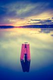 Vintage photo of beautiful sunset over calm lake Stock Images