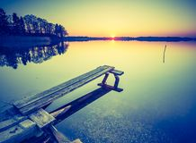 Vintage photo of beautiful sunset over calm lake Royalty Free Stock Images