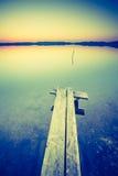Vintage photo of beautiful sunset over calm lake Stock Image
