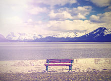 Vintage photo of bench at the lake shore. Stock Photography