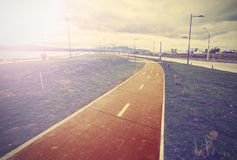 Vintage photo of bicycle lane along the harbour. Royalty Free Stock Photo