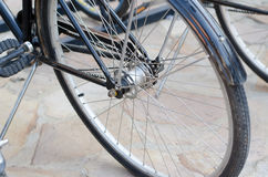 Vintage photo of a bicycle wheel. Vintage photo of a bicycle wheel parked Stock Photography