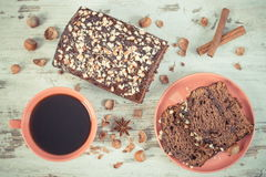 Vintage photo, Black coffee, dark cake with chocolate, cocoa and plum jam, delicious dessert Stock Photography
