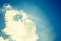 Vintage photo of blue sky with white clouds Stock Images