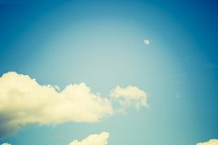 Vintage photo of blue sky with white clouds Stock Photo