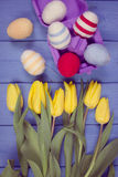 Vintage photo, Bouquet of fresh tulips and Easter eggs wrapped woolen string, Easter decoration Stock Image