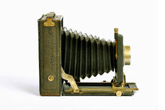 Vintage photo camera. Vintage bellows photo camera isolated on white Royalty Free Stock Images