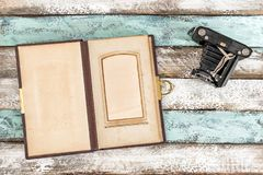 Vintage photo camera and photo album pictures. Vintage photo camera and photo album for pictures on wooden background stock images