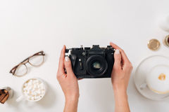 Vintage photo camera being in hands of a female photographer Royalty Free Stock Photo