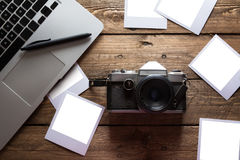 Vintage photo camera. Blank photo frames. Royalty Free Stock Photography