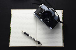 Vintage photo camera on the book Royalty Free Stock Images