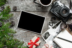 Vintage photo camera on christmas wooden background with blank photo frame Stock Images