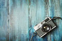 Vintage photo camera on grunge wooden background stock photography