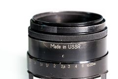 Vintage photo camera lens close up with made in ussr text Royalty Free Stock Photography