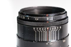 Vintage photo camera lens close up showing aperture and distance scale Royalty Free Stock Photos