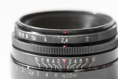 Vintage photo camera lens close up showing aperture and distance scale Royalty Free Stock Images