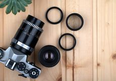 Vintage photo camera, lens and macro rings. royalty free stock photos