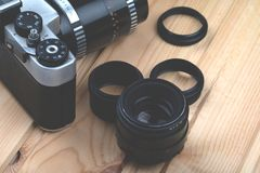 Vintage photo camera with the macro rings. royalty free stock photo