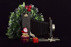 Vintage photo camera and merry Christmas royalty free stock photo