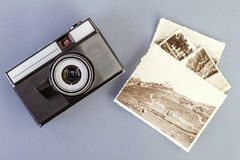 Vintage photo camera and old photos Royalty Free Stock Images