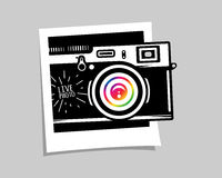 Vintage photo camera out of photoframe Royalty Free Stock Images