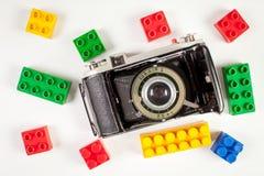 Vintage photo camera and plastic blocks Stock Photo